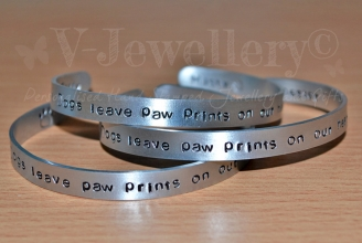 """Dogs leave paw prints on our hearts"" Torque Bangle - One Size 6"""