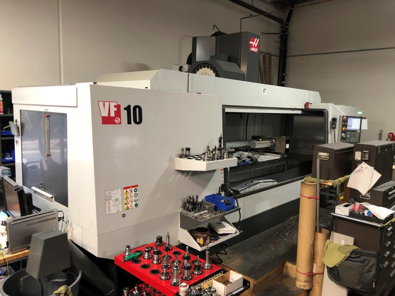 Haas VF-10/40 VMC 2017 with: Haas CNC Control, 4th Axis Drive and Wiring, Haas HRT210-2, 30+1 High Speed Mount Tool Changer, Programmable Coolant and Nozzle, Minimum Quantity Lubrication, Remote Jog Handle, Coolant Tank, and Chip Auger.