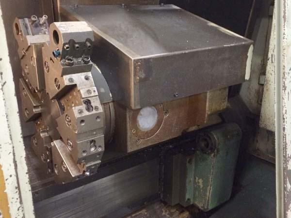 """TONGTAI Quasar 250, Fanuc OT, 15"""" Swing, 8"""" 3-Jaw Power Chuck, Tailstock w/ 23"""" Centers, 12 Position Turret, Chip Conveyor, 1993."""