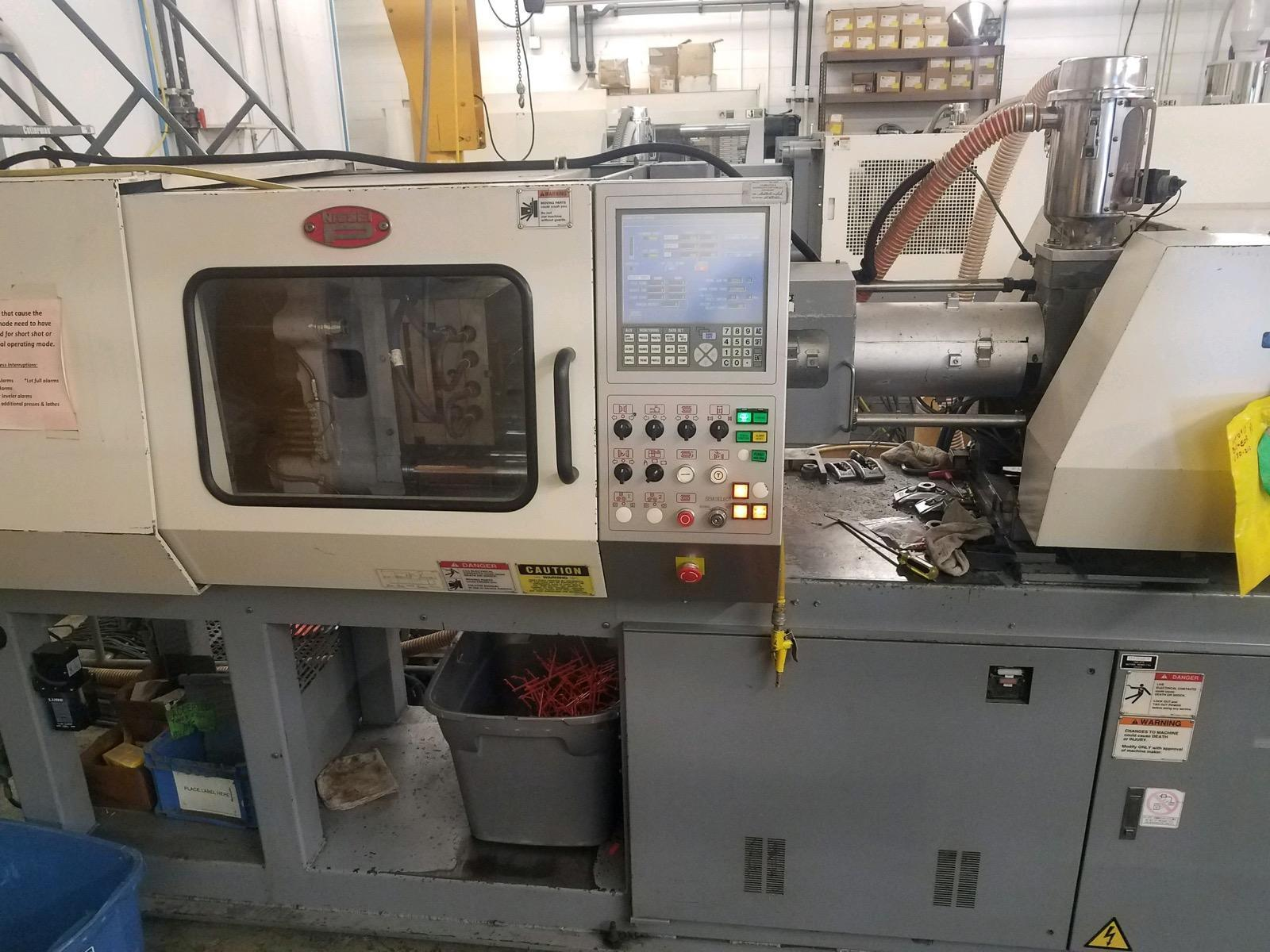 Nissei ES600-9E Used Injection Molding Machine, 66 US ton, 2.9 oz. yr 2003