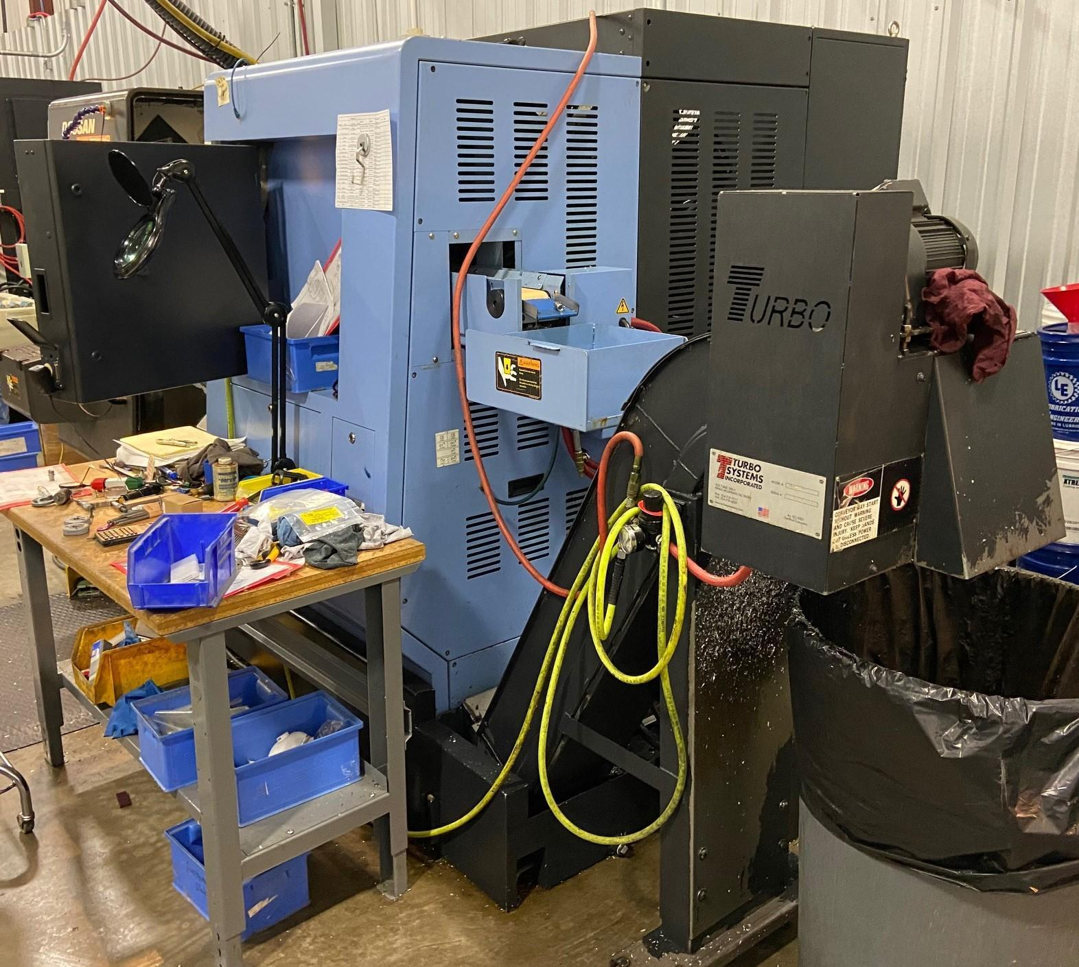 Doosan Puma TT1500SY Twin Turret Multi-Axis CNC Lathe 2007 with: Fanuc Series 18i-TB CNC Control, Twin Spindle, Tool Setter, and Chip Conveyor.
