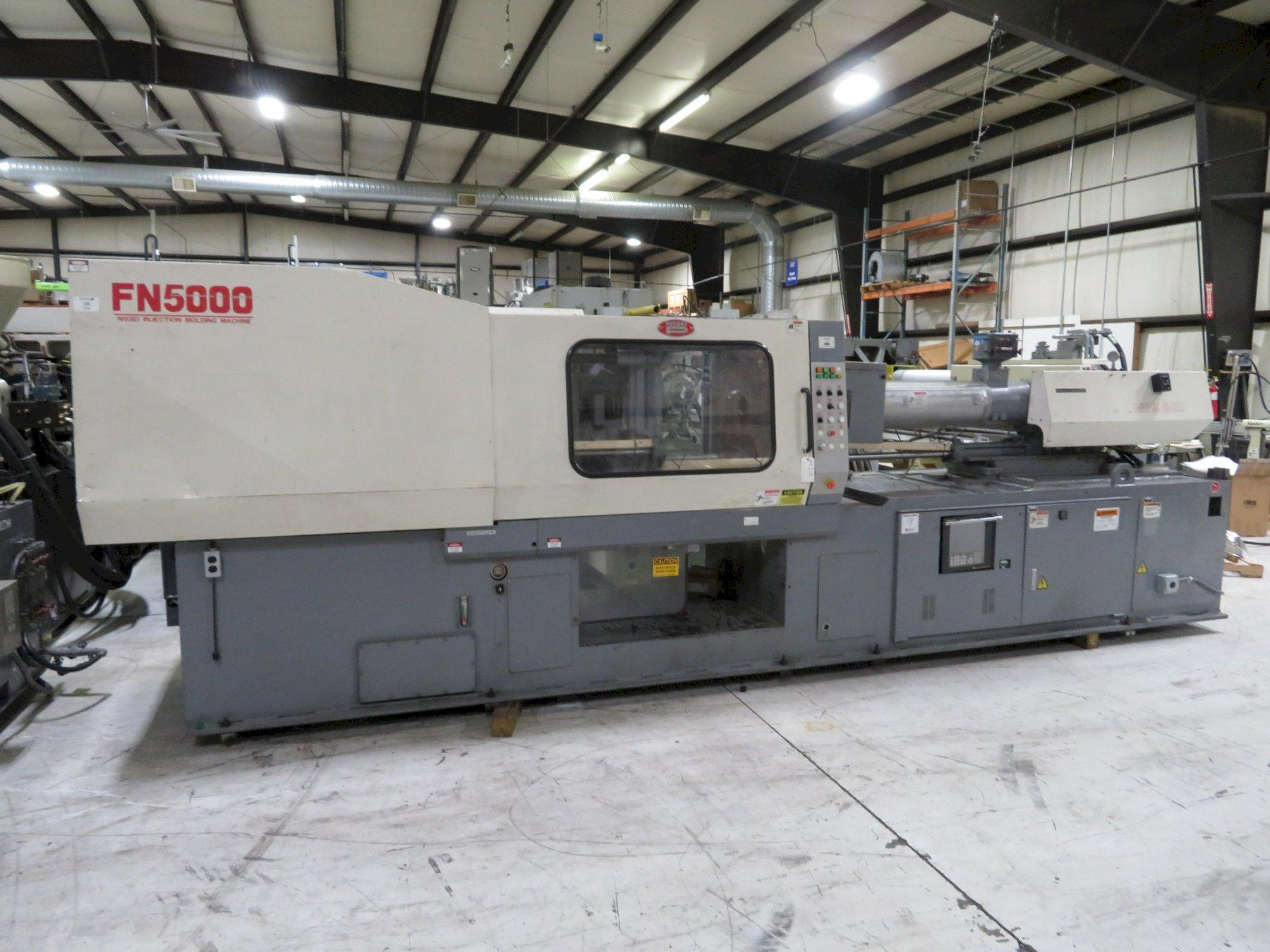 Nissei Used FN5000 Injection Molding Machine, 240 US ton, Yr. 2000, 21.4 oz.
