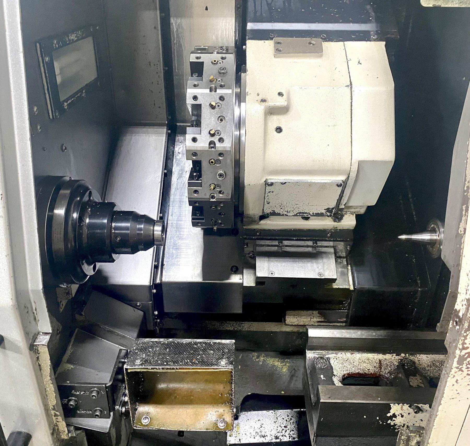 "OKUMA HERITAGE ES-L8II CNC TURNING CENTER, Okuma OSP-U10L CNC Control, 5C Royal Collet Chuck, Tailstock w/ 20"" Between Centers, 18"" Max Swing, 2"" Bar Capacity, Tailstock, Chip Conveyor, New 2007."