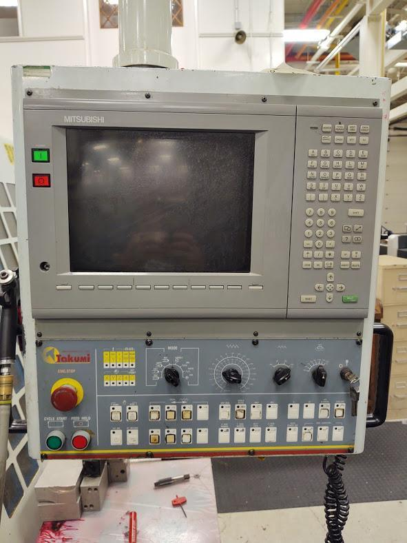TAKUMI Model V18A CNC Vertical Machining Center, S/N J0149, New 1999.