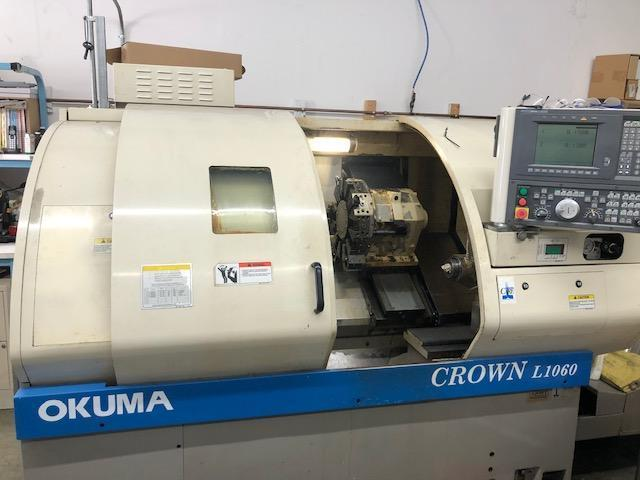 Okuma Crown L1060 CNC Lathe 2000 with: Okuma OSP-U10L CNC Control, Tailstock, Chip Conveyor, and Manuals.