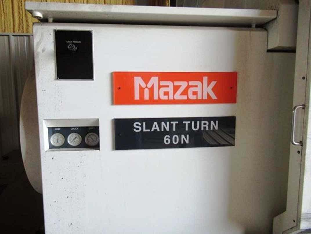 """MAZAK SLANT TURN 60N, Mazatrol Fusion 640 CNC, 36"""" Swing Over the Bed, 28"""" Swing Over the Cross Slide, 120"""" Between Centers, 15"""" Spindle Bore, 10 Position Tool Turret, 60 HP, 1000 RPM, New 2011."""