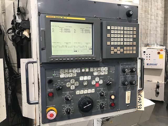 """OKUMA HOWA 2SP-V40 VERTICAL TURNING CENTER, Fanuc 18T CNC Control, 20"""" Swing, 17"""" Max Turning Height, (2) 28HP Spindles, New 2001."""