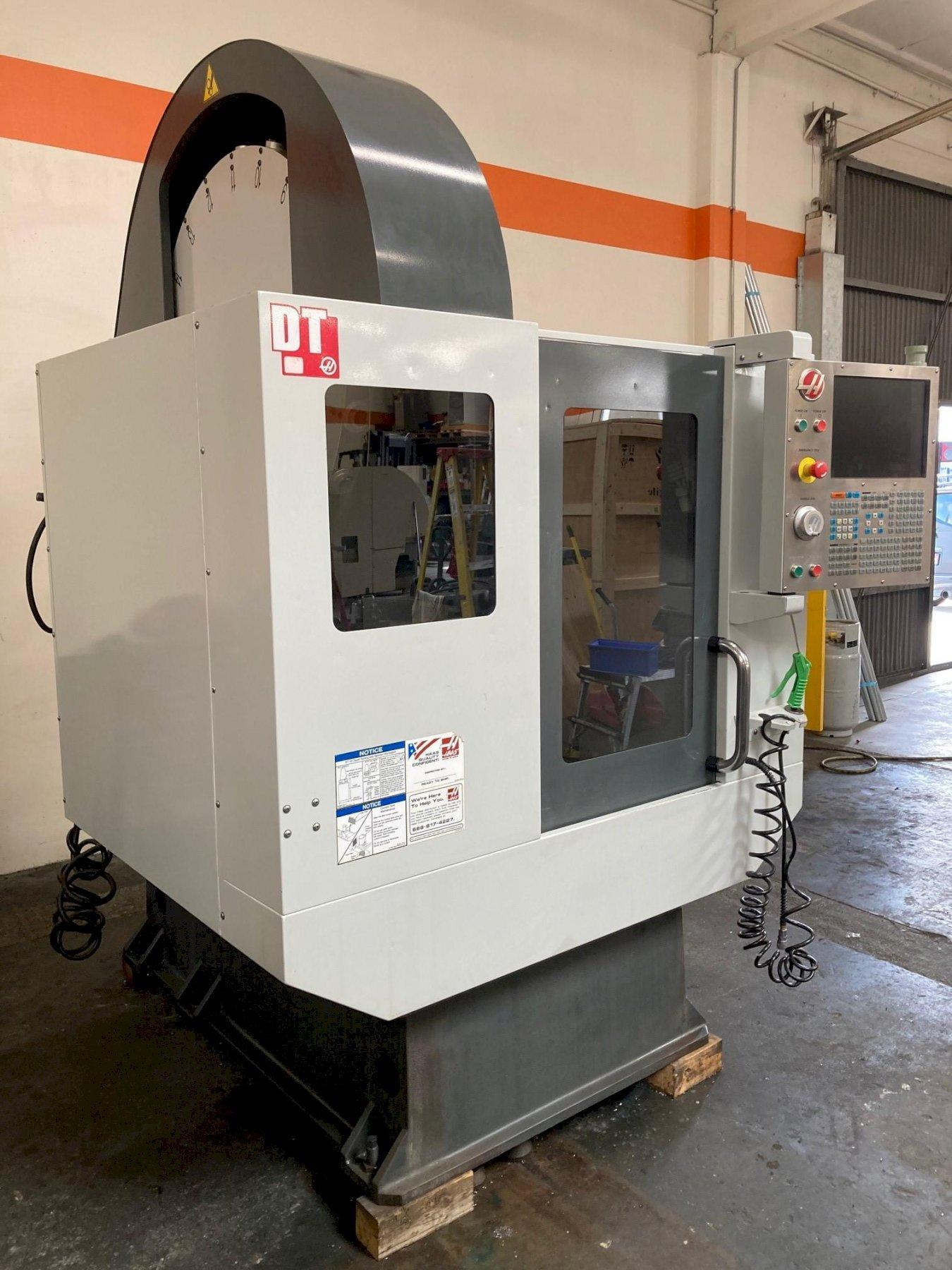 Haas DT-1 VMC 2010 with: Haas CNC Control, 4th Axis Drive, Programmable Coolant, Chip Auger, and Coolant System.