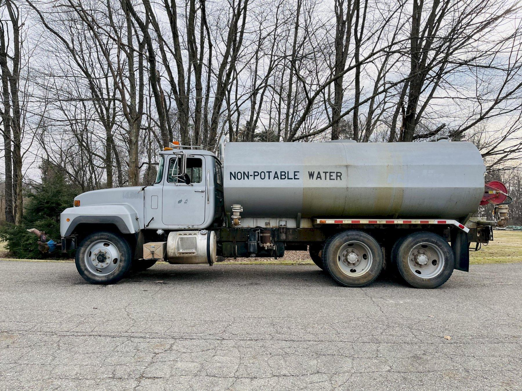 Mack RD688S Water Truck with Dolphin 4000 Gallon Tank and Berkeley Pump w/ Six Spray Heads
