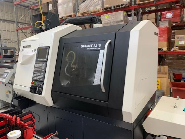 DMG Mori Sprint 32/8 CNC Swiss Automatic Screw Machine 2017 with: Fanuc 32i CNC Control, Iemca Bar Feeder, Chip Blaster, Mist Buster, and Coolant Tank.