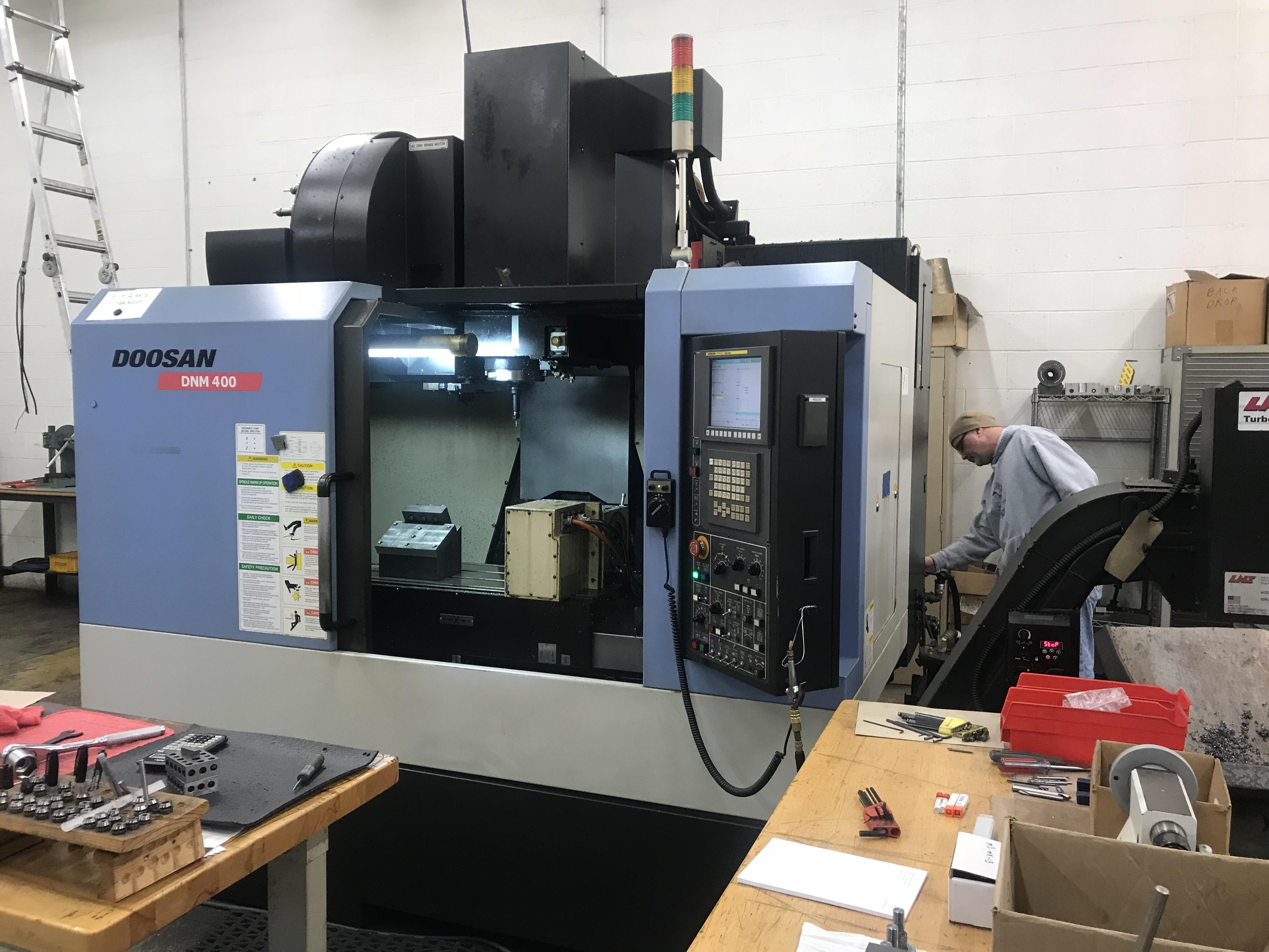 "Doosan DNM-400 CNC Vertical Machining Center, Fanuc Series i, 30""x/17""y/20""z, 8K Spindle, 30 ATC, Hi-Pressure Coolant Thru Spindle, 4th Axis Rotary, Chip Conveyor, Very Low Hours, 2011"