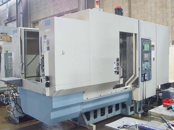 "OKK HM-4, Fanuc 21i CNC Control, X=22"", Y=20"", Z=22"", (2) 15.7"" Square Pallets, 1 Degree Indexing, 40 Station Tool Changer, Thru Spindle Coolant, Hyd Part Clamping, New 2002."