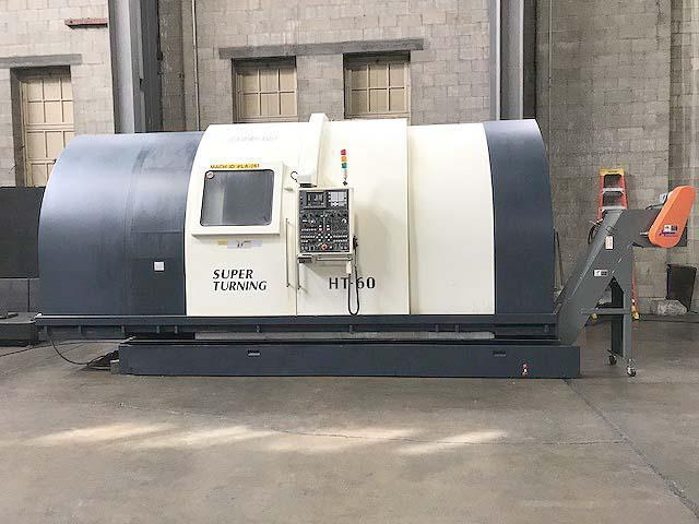 "JOHNFORD HT-60C-2D, Fanuc 18T CNC 34"" Swing, 24"" Chuck, 60"" Between Centers, 4-Axis Upper and Lower Turrets, New 2004."