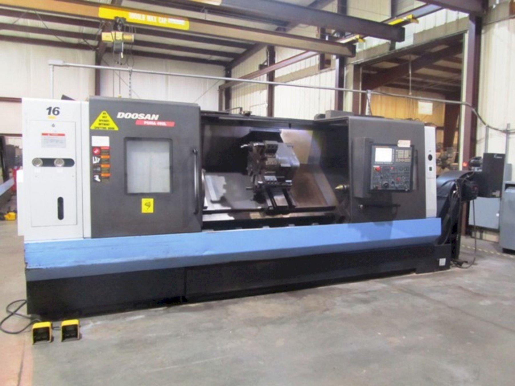 """DOOSAN PUMA 480L CNC TURNING CENTER, Fanuc 32i CNC Control, 24'' 3-Jaw Chuck, Max 36'' Swing, Tailstock with 84"""" Centers, 63 HP Spindle, 1500 Max Spindle RPM, 12-Position Turret, Tool Setter, Chip Conveyor & Coolant System, New 2014."""