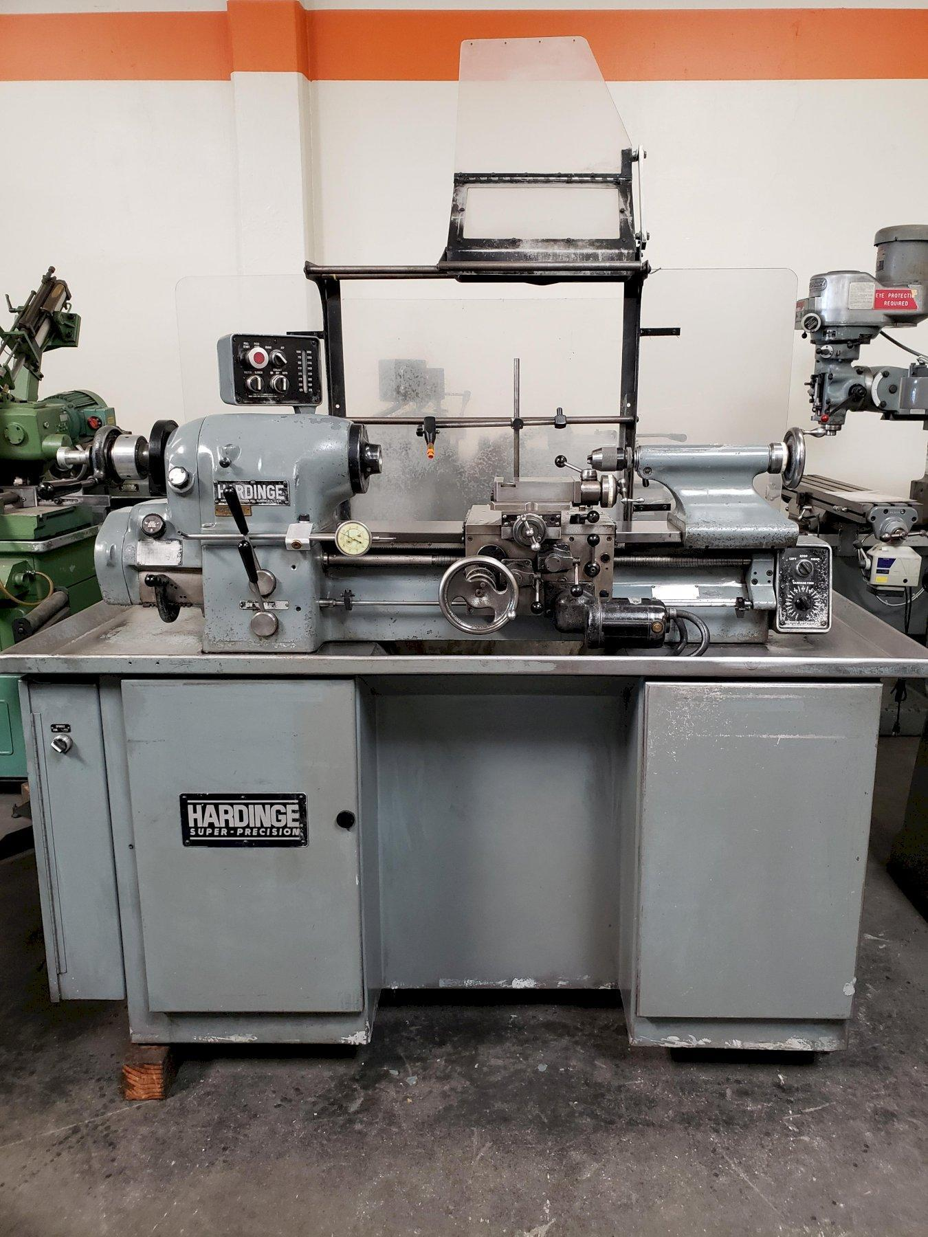 Hardinge HLV-H High Speed Tool Room Lathe with: Tool Post, Tailstock, Collet Nose, and Splash Guard.