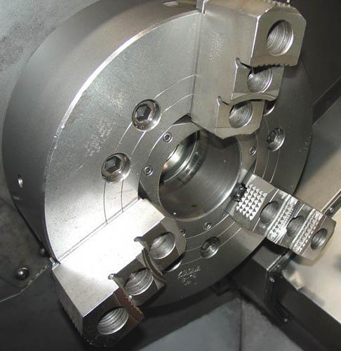 """OKUMA CROWN L1420/650 CNC TURNING CENTER, OSP U10L CNC Control, 28"""" Swing, 15"""" 3-Jaw Kitagawa Hydraulic Chuck, 25"""" Max Turning Length, 3.15"""" Spindle Bore, 30 HP, 3500 RPM, 12-Position Turret, Chip Conveyor, Coolant System, New 1999."""
