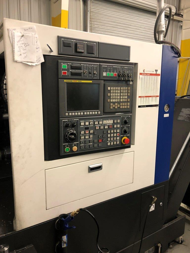 Hyundai L2600SY Multi Axis CNC Lathe 2015 with Fanuc Control, Tool Presetter, Quick Load Servo 80 S2 Bar Feed, Chip Conveyor, and Coolant Tank.