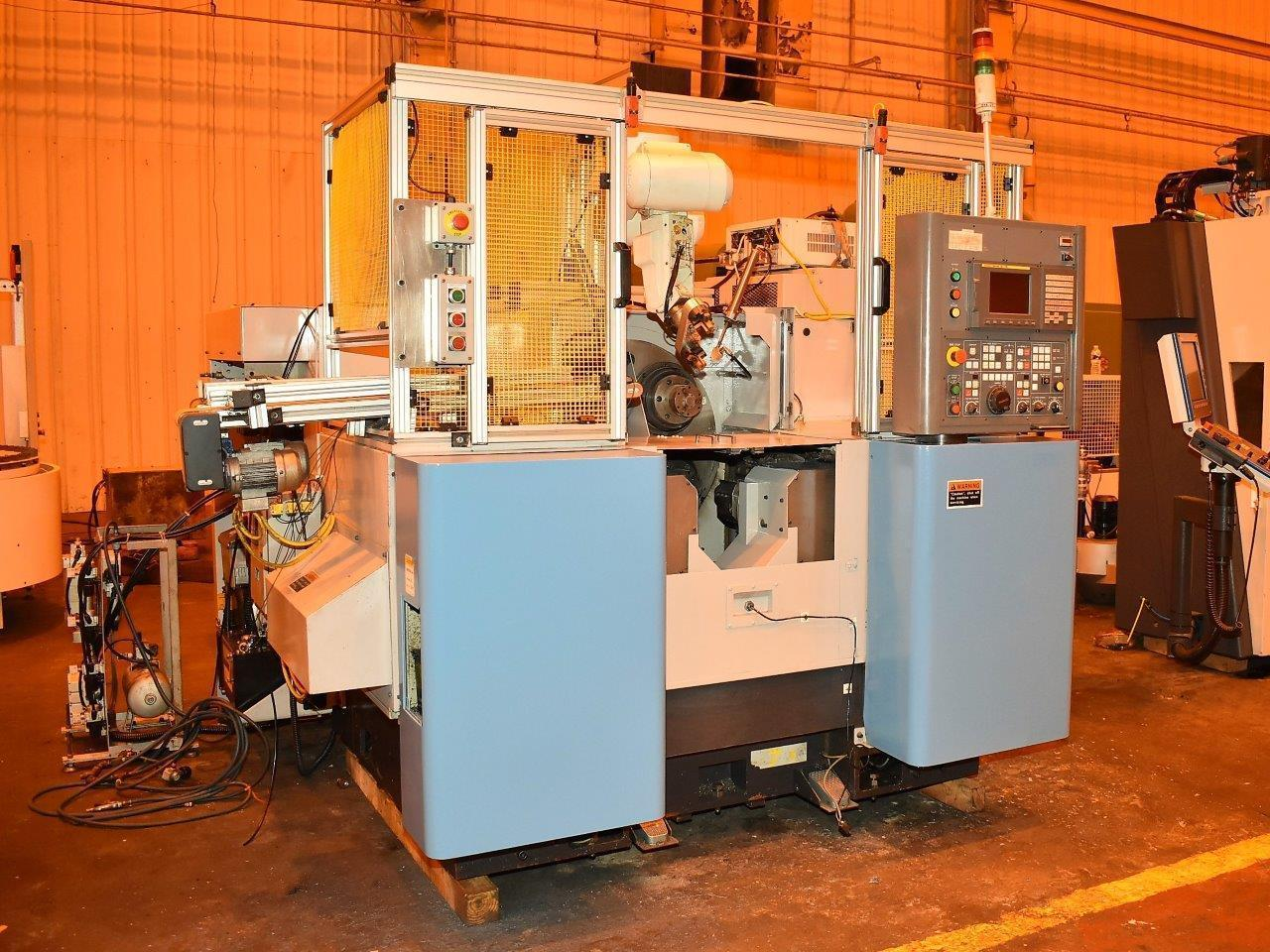 Kitako Model HS4200N CNC Multi Spindle (4) Automatic Lathe, with 4-Spindles (4-Northfield Chucks), Fanuc 18iTB Control, 4-Chucks, Mitsubishi Robotic Loader, New 2009