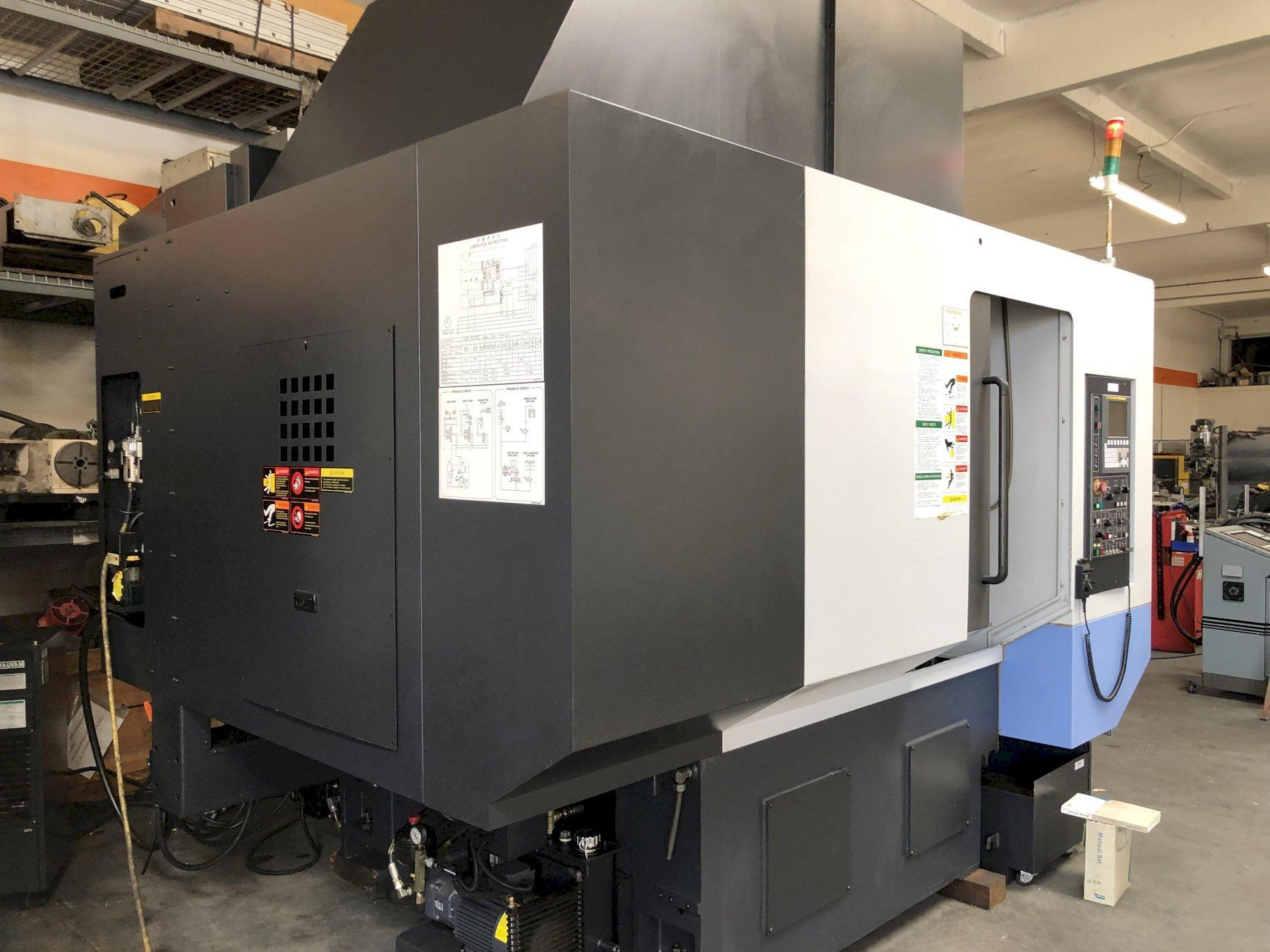 Doosan VC 510 VMC 2012 with: Pallet Changer, Fanuc i Series CNC Control, Probing, Through Spindle Coolant, and LNS Turbo Chip Conveyor.