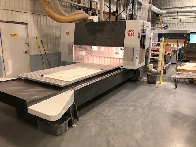 Haas GR-510 CNC Router 2014 with: Haas Control, 10,000 RPM Spindle, 40-Taper, 50-HP Motor, 20 Position Automatic Tool Changer, Rigid Tapping, and Remote Jog Handle.  ** Vacuum Table In Pictures Not In