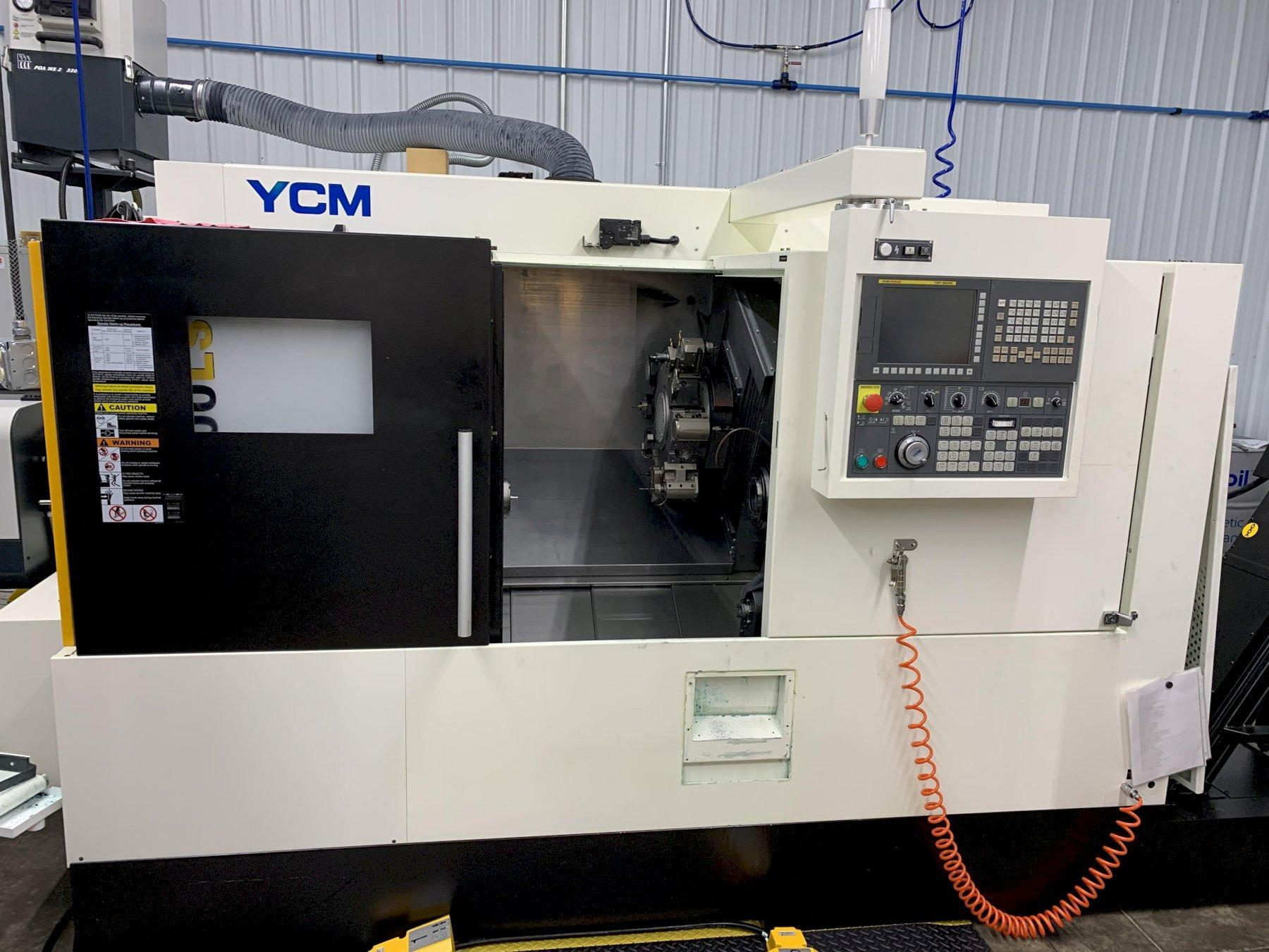 YCM NTC-1600LSY CNC Lathe 2017 with: Fanuc TXP-200FA CNC Control, Live Tooling, Sub-Spindle, Tool Setter, and Chip Conveyor.