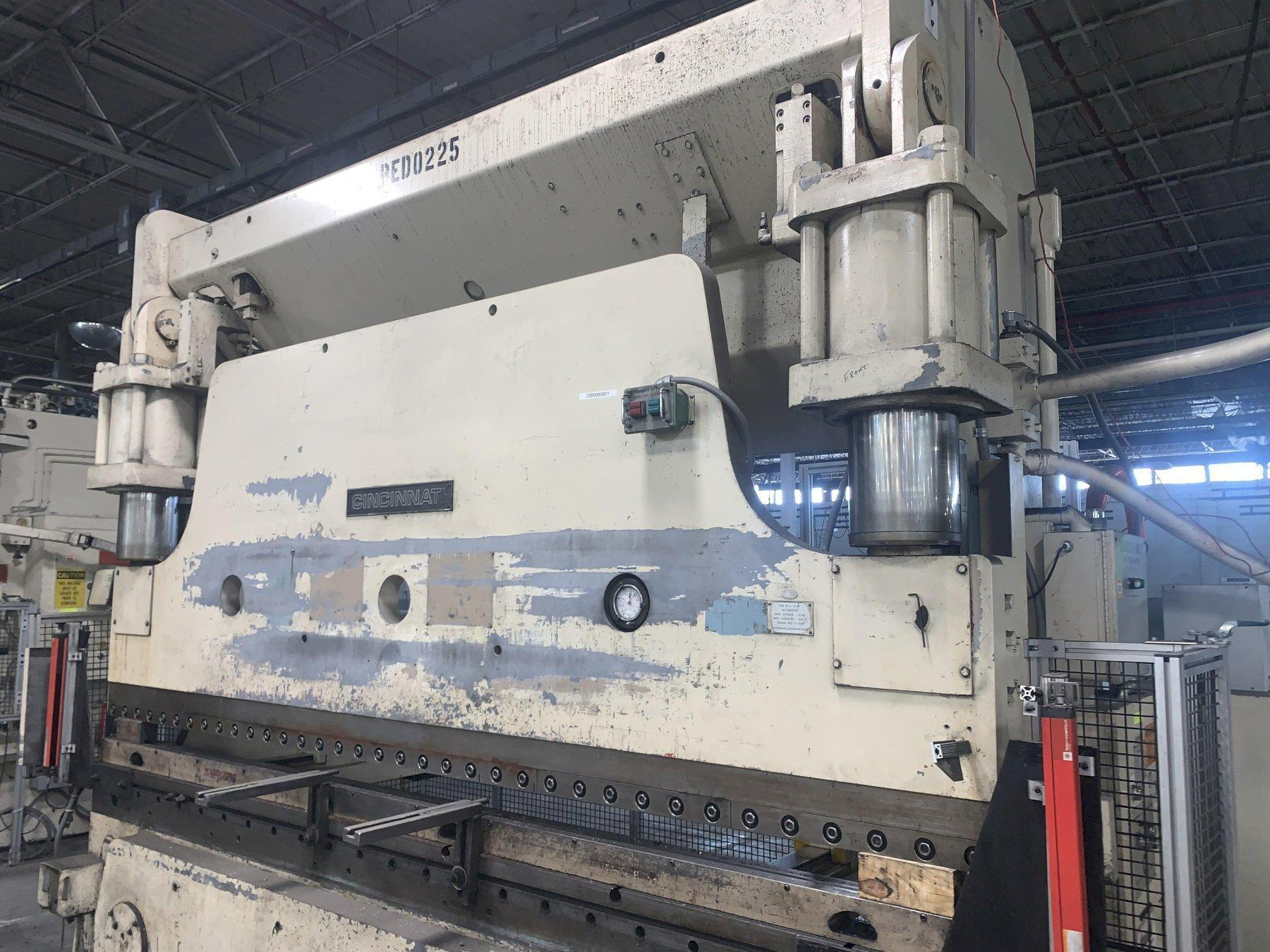 230 TON X 12' CINCINNATI MODEL #230-10AS AUTO SHAPE HYDRAULIC CNC PRESS BRAKE WITH UPGRADED TOUCHSCREEN CONTROLS. STOCK # 1801120