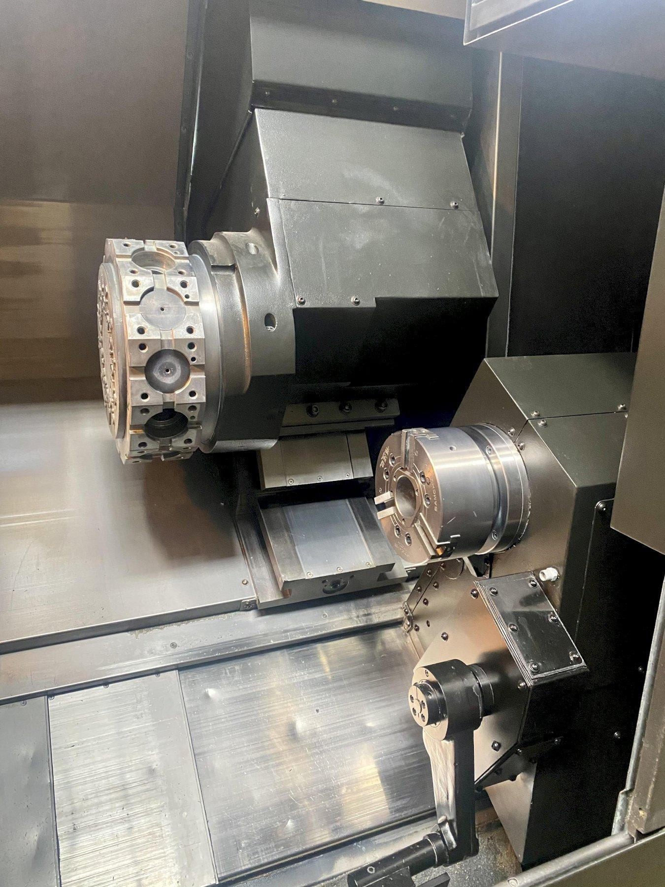 """DOOSAN PUMA 2600SY CNC TURNING CENTER, Fanuc 31i CNC Control, 10"""" & 8"""" 3-Jaw Chuck Main & Sub Spindle, 12 Station Turret w/ Live Tooling, Y & C-Axis, Parts Catcher, Chip Conveyor & Coolant System, New 2011."""