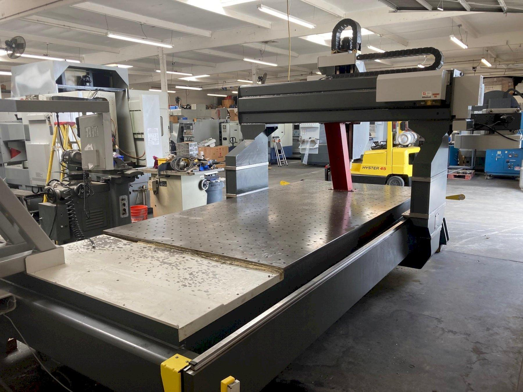 "Haas GR-712 CNC Router 2010 with: 144"" x 72"" Table, 145""x85""x11"" Travels, 10-ATC, 15-HP Motor, and 8100 RPM Spindle."