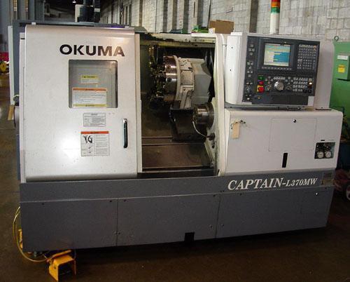 "Okuma Captain L-370 BBMW, OSP E100L CNC Control, 10"" Main Chuck, 6.5"" Sub-Spindle, Live Tooling, C-Axis, Low Hours, New 2005."