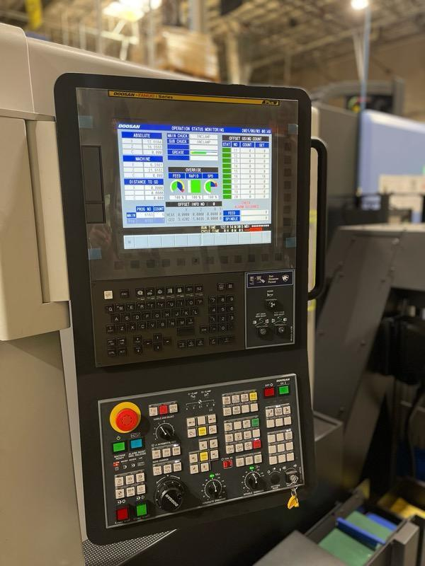 Doosan Lynx 2100LSYB Multi-Axis CNC Lathe 2020 with: Fanuc i Series CNC Control, Live Tooling, Royal Collet Chucks, Collets, Tool Setter, Y-Axis, and Chip Conveyor.