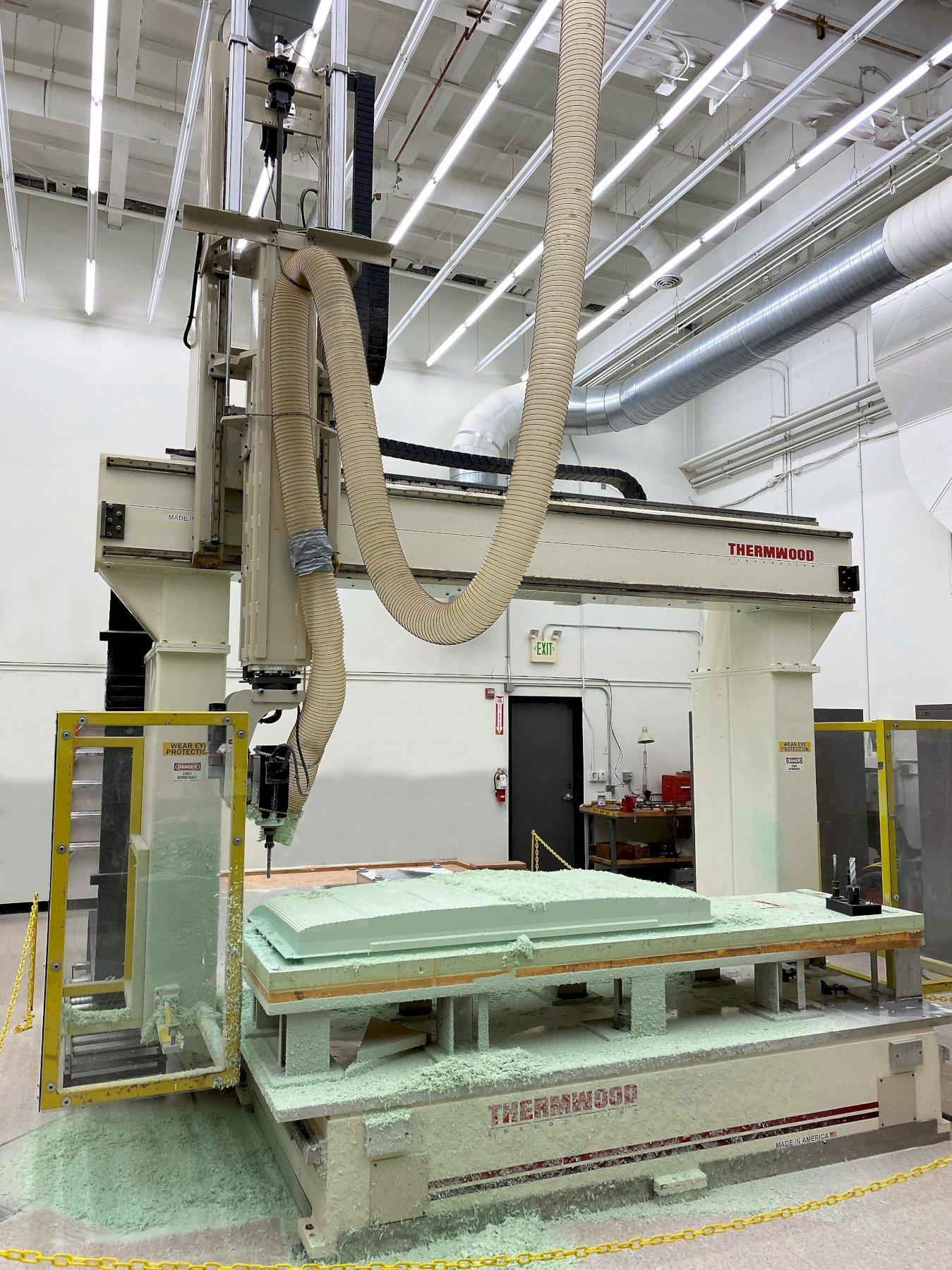 Thermwood Multipurpose 70 5-Axis CNC Router 2007 with: 91000 Gen II Control with Windows XP, Impact Resistant Head, Auto Tool Length Sensor, and Upgraded 9.6-HP HSK Tool Change Spindle.