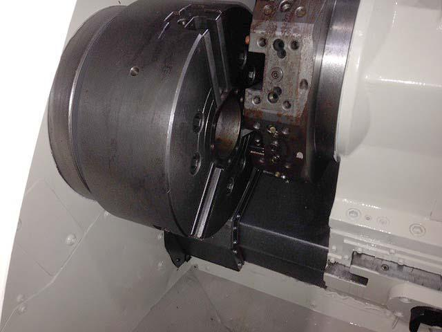 """OKUMA CROWN L1420 BIG BORE, OSP U10L CNC Control, 28"""" Swing Over the Bed, 19 Swing Over Saddle, 15"""" 3-Jaw Chuck, 3.15"""" Spindle Bore, 31"""" Between Centers, New 2001."""