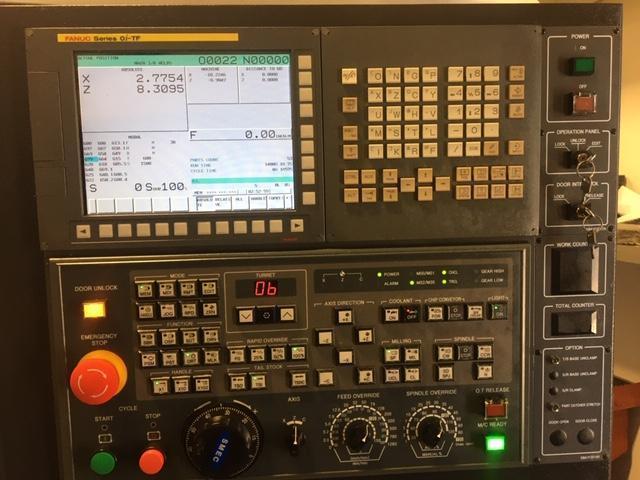 "Samsung SMT SL-1500 CNC Lathe 2017 Fanuc Oi-TF CNC Control, 6"" Chuck, Tool Presetter, 12-Position Turret, Tailstock, and Coolant Tank."