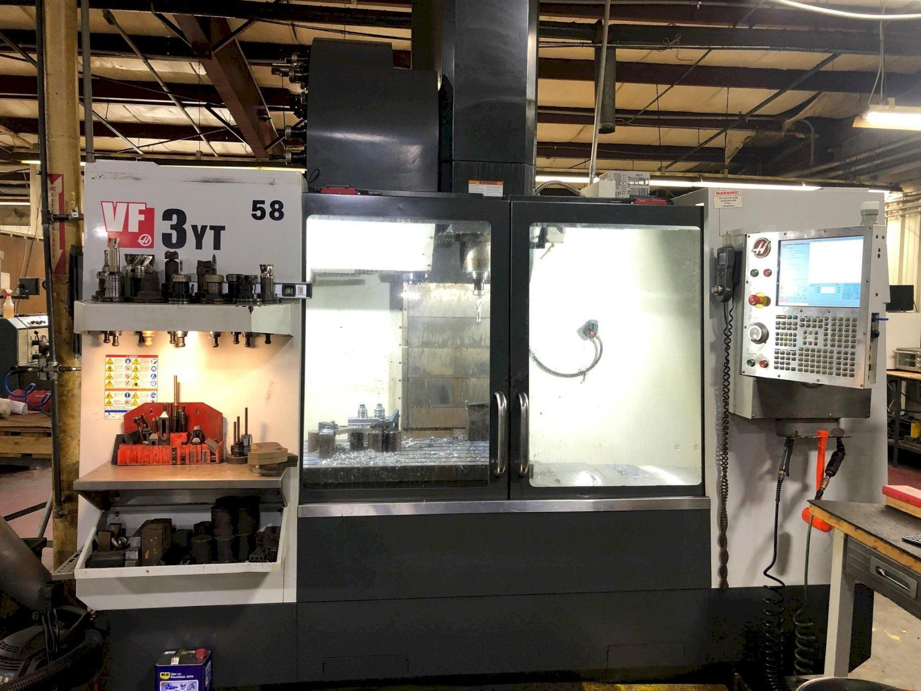 HAAS MDL. VF-3 YT/50 CNC VERTICAL MACHINING CENTER, 8,100 RPM, 30- ATC, HAAS CNC CTRL, Probe, Wired 4th, 30HP New 2012