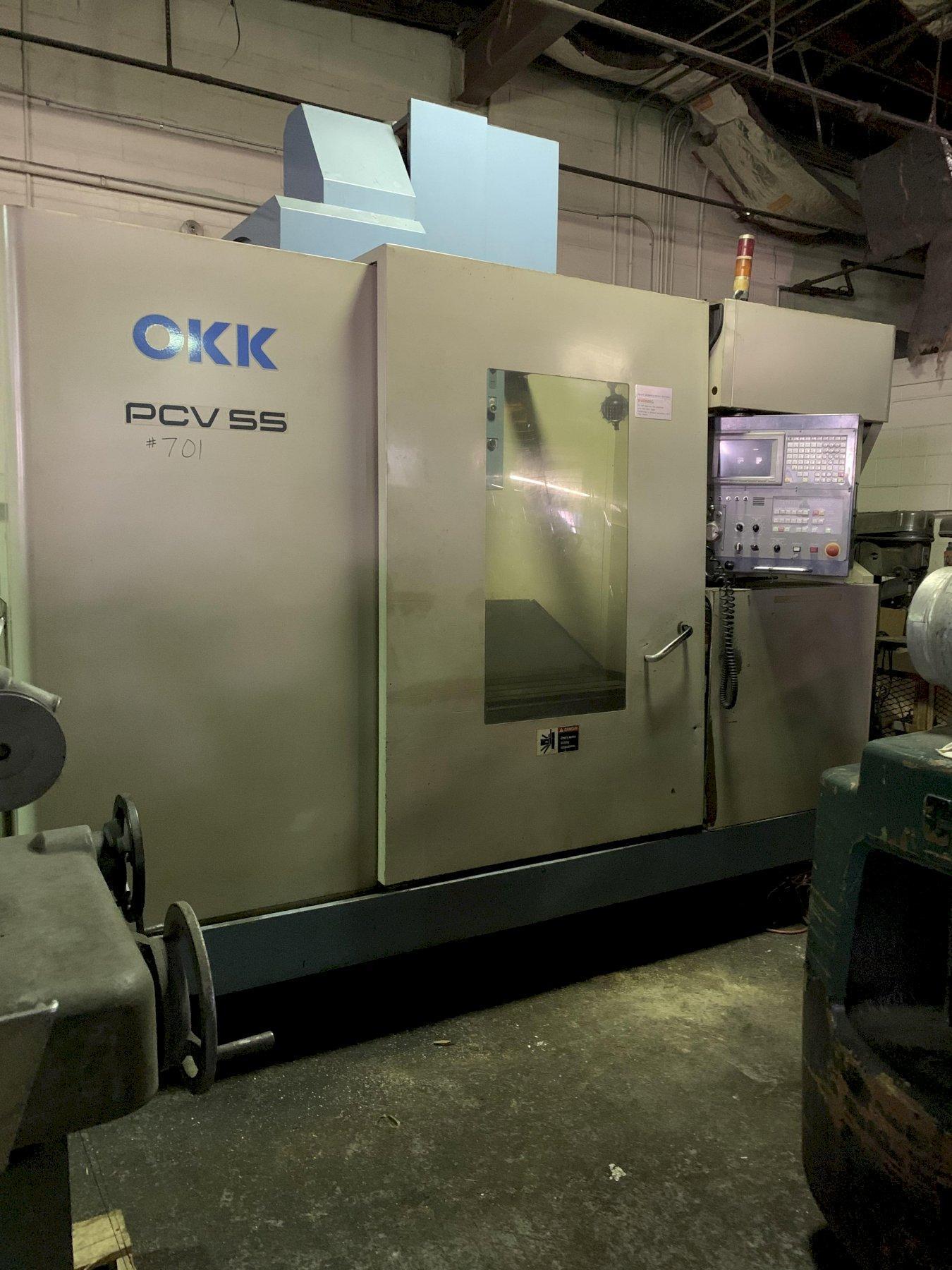 "OKK PCV-55 CNC VERTICAL MACHINING CENTER 48"" x 22"" TABLE, CAT 50, 20 TOOLS"