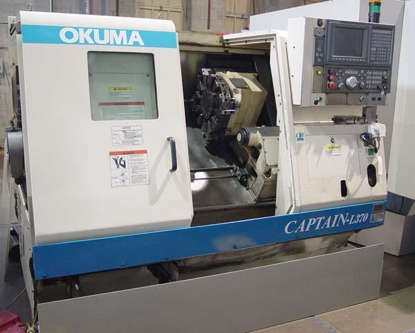 "OKUMA CAPTAIN L370 Big Bore, OSP E100L CNC, 10"" Chuck, 20.08"" Swing, 14.56"" Turning Diameter, 20.47"" Centers, New 2001."
