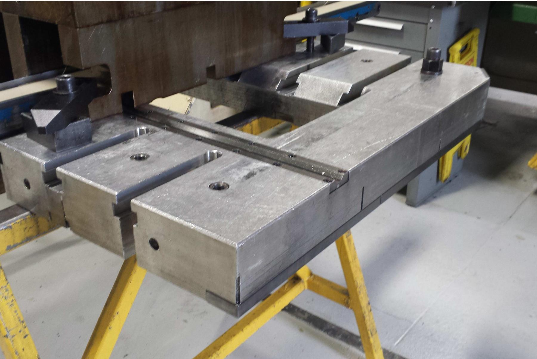 """33.5"""" x 75""""  T-Slotted Minster bolster plate, 9.8"""" x 63"""" cutout, 4.92"""" thick, 11 t-slots"""