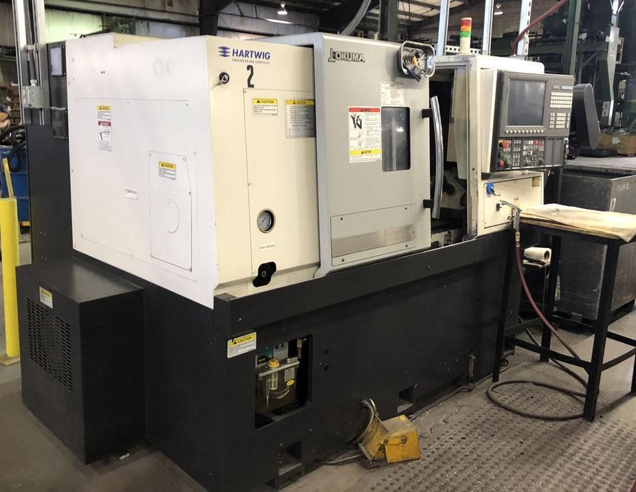 "2013 Okuma L-400 CNC Turning Center, OSP-P300L-R CNC Control, 12 Postion Turret, Turret Index Time: 0.3 Seconds, 8"" 3 Jaw Hydraulic Chuck, Max. Turning Diameter: 12.2"", A2-6 Spindle Nose, 25-3000 Max RPM, 20/15 Main Spindle H.P., Rapid Traverse: 787/984 IPM, Travels: X-20"", Z-25"", Tailstock: MT5 Revolving Center, Chip Conveyor"