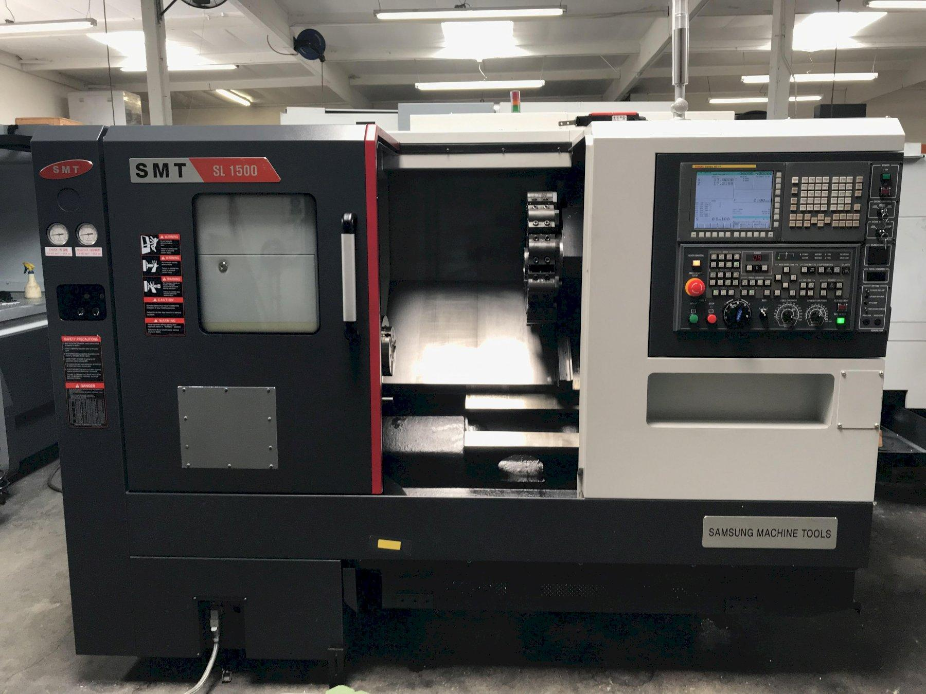 """Samsung SMT SL-1500 CNC Lathe 2017 with: Fanuc Oi-TF Control, 6"""" Chuck, Tool Presetter, Tailstock, 6000 RPM Spindle, 20.07"""" Max Swing, 12-Position Turret, and Coolant Tank."""