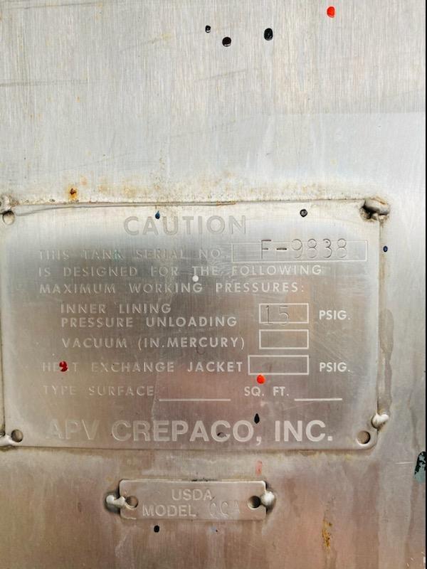 1500 GALLON APV CREPACO STAINLESS STEEL VERTICAL TANK. STOCK # 0519821