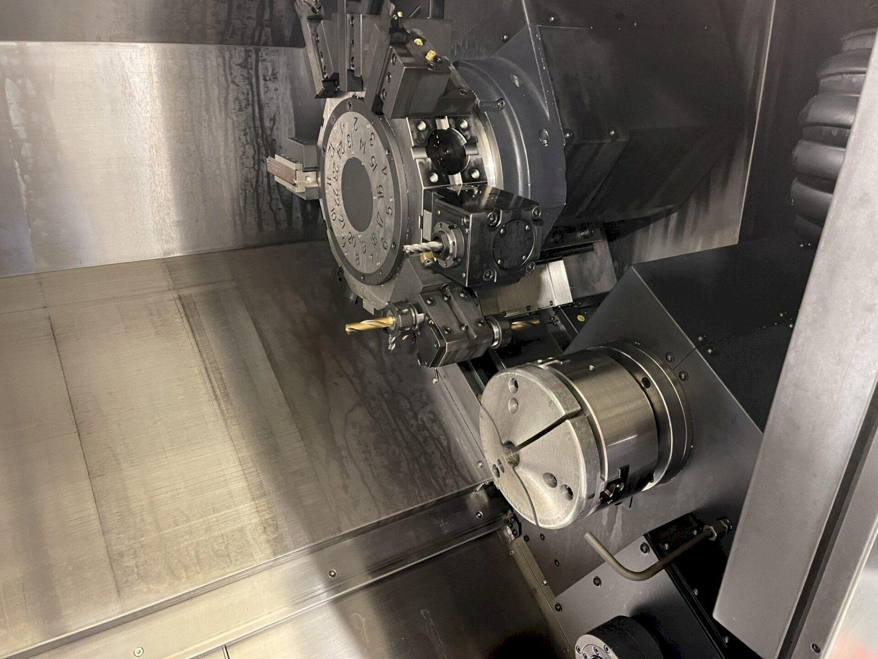 Doosan Puma 2600SY II CNC Lathe 2017 with: Fanuc i Series CNC Control, Live Tooling, Sub Spindle, Auto Tool Presetter, Chip Auger, and Hennig Chip Conveyor.