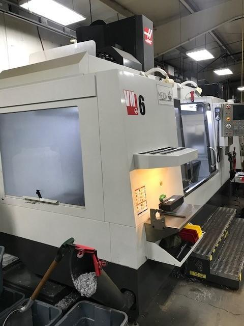 """HAAS VM-6 CNC VERTICAL MACHINING CENTER High-Performance Specialty Mold & Die Machine, Haas CNC Control, 64"""" x 28"""" Table, X=64"""", Y=32"""", Z= 30"""", Cat 40, 30 HP, 12,000 RPM, 24 ATC,  Renishaw Probe System,  4th Axis Ready, Chip Auger, Coolant, New 2013."""