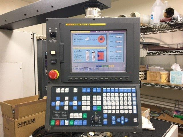 Fanuc Robocut Alpha-OiC Series Wire EDM 2004 with: Fanuc Series 180is-WB CNC Control, Dielectric System and Filter, Chiller, and Transformer.