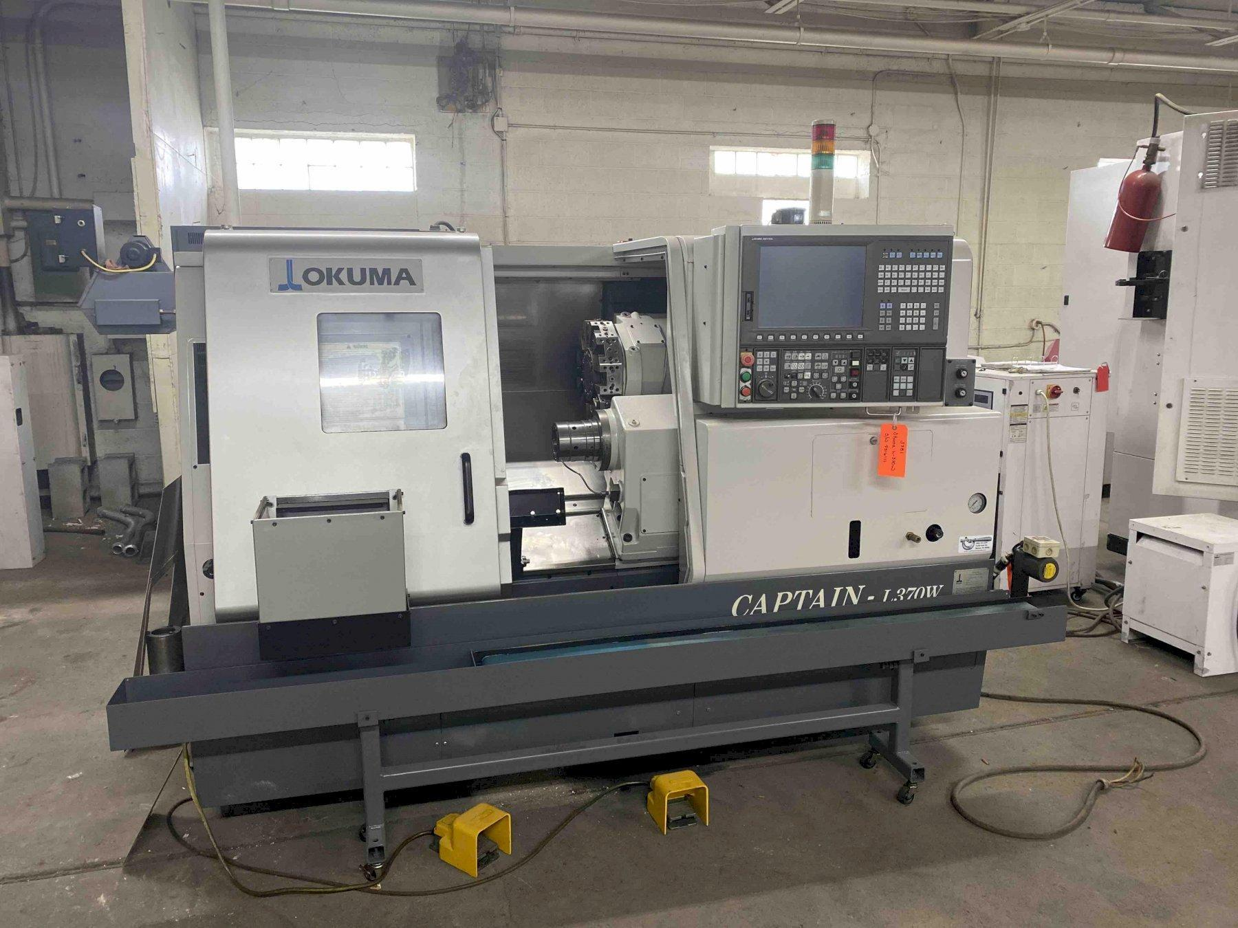 "Okuma Captain L370BBW CNC Lathe, OSP P200L, 21"" Swing, 3.15"" Bar Capacity, Subspindle, 12 Position Turret, 3800 RPM, 20 HP,  Parts Catcher, Parts Conveyor, Tool Eye, Bar Feed, Collet Chucks, Holders, Low Hours, 2007"