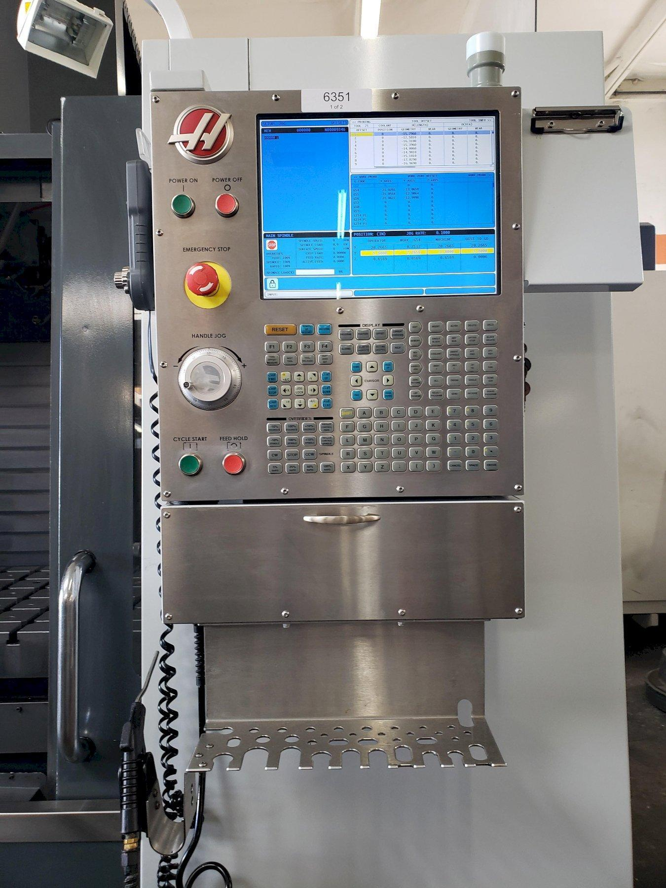 Haas VM-3 Mold Maker 2014 with: Haas Control, Probe, Programmable Coolant, Chip Auger, and Coolant Tank.