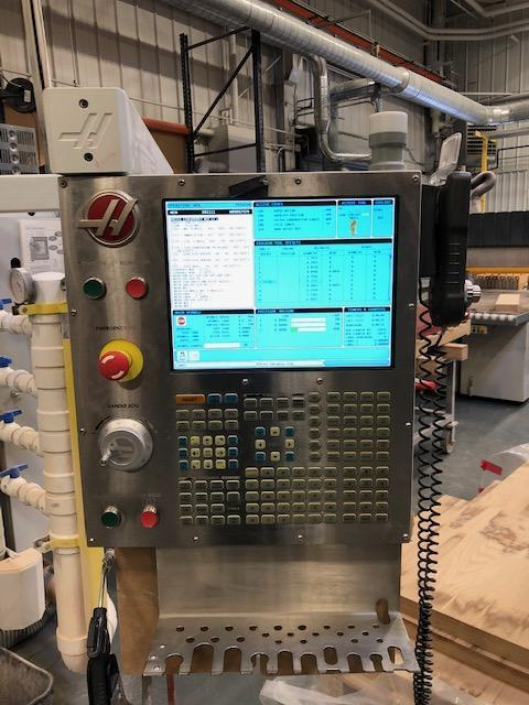 Haas GR-510 CNC Router 2014 with: Haas Control, 10,000 RPM Spindle, 40-Taper, 50-HP Motor, 20 Position Automatic Tool Changer, Rigid Tapping, and Remote Jog Handle.  ** Vacuum Table In Pictures Not Included.  Router  Comes With Factory Table.