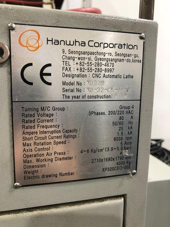 Hanwha XD32H CNC Swiss Lathe 2014 with: Fanuc i Series CNC Control, 12' Edge Patriot 338 Bar Loader, High Pressure Coolant, Misc. Tooling, Mist Collector, and Chip Conveyor.