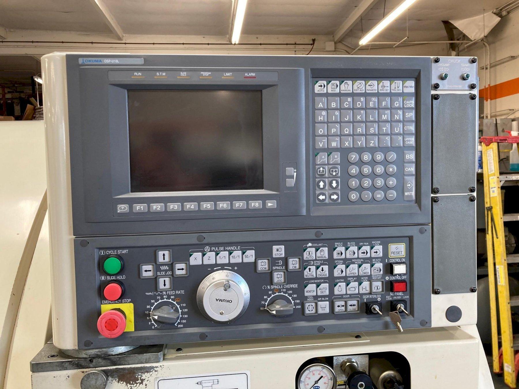 Okuma Crown L1060 CNC Lathe 2000 with: Okuma OSP-U10L CNC Control, Tailstock, Chip Conveyor, and Manuals.