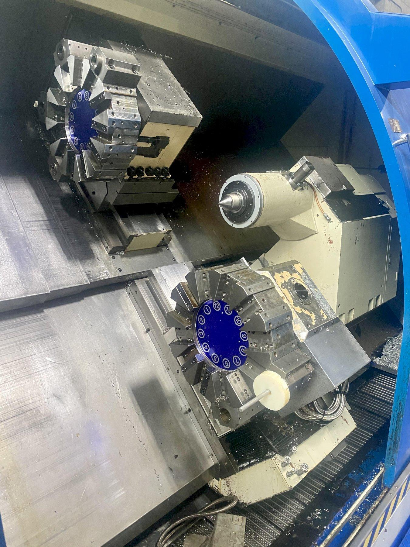 """JOHNFORD HT-40A-2D 4-AXIS CNC TURNING CENTER, Fanuc 18T CNC Control, 29.5"""" Swing, 12"""" 3-Jaw Chuck, 40"""" Between Centers, (2) 12 Position Turrets, 4"""" Spindle Bore, Chip Conveyor, New 2005."""