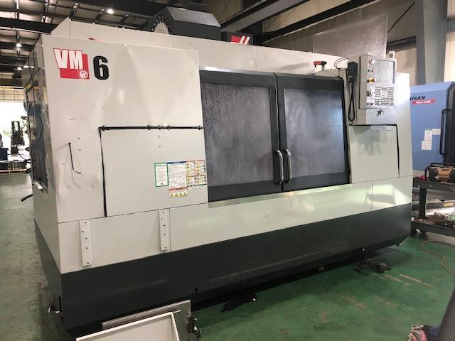 Haas VM-6 VMC 2011 With: Haas CNC Control, MGP, Chip Auger, Coolant Tank, and Filter Unit.